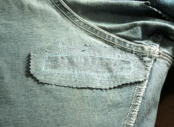 excess fabric cut off from jean patch