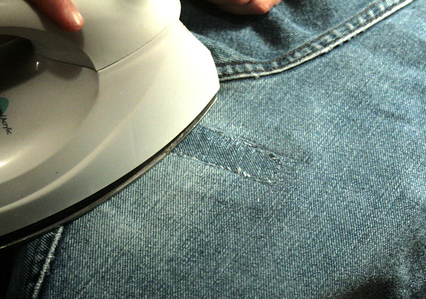 ironing the jean's new patch