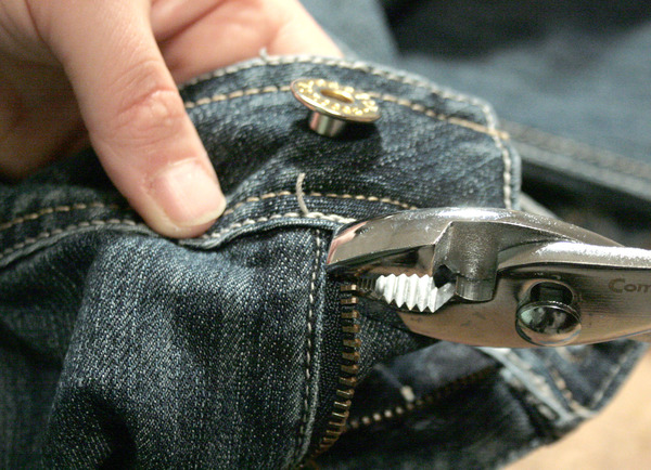crimping the top zipper stop to the zipper track