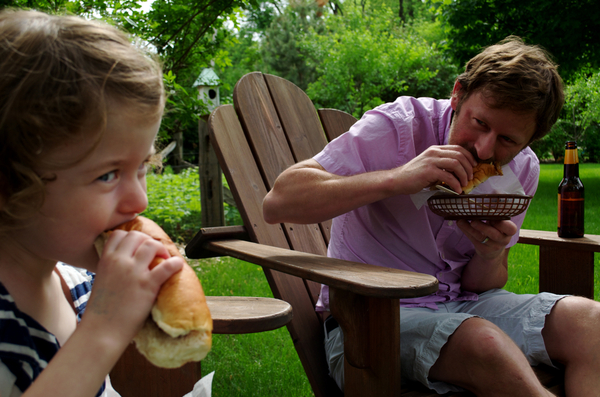 Enjoying a hot dog with dad!