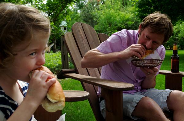 Enjoying a hot dog with dad!