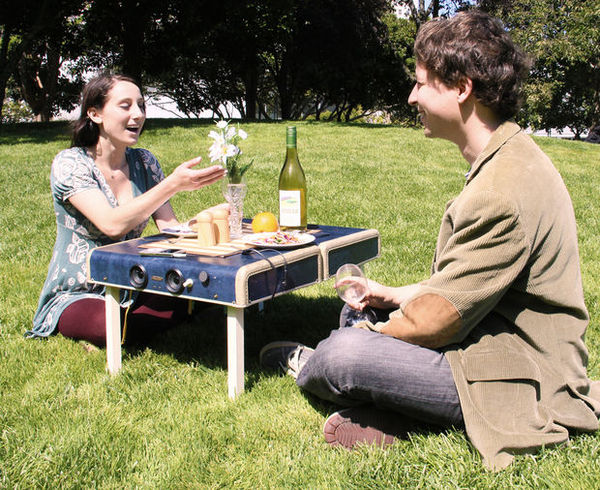 Turn a suitcase into a picnic table and mp3 player