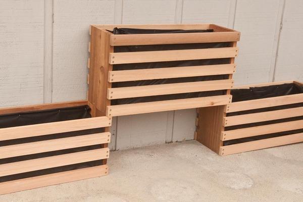 assembling the vertical garden frames against a wall