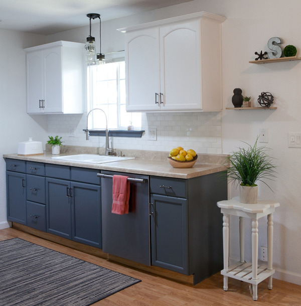 Painted cabinetry with added crown molding