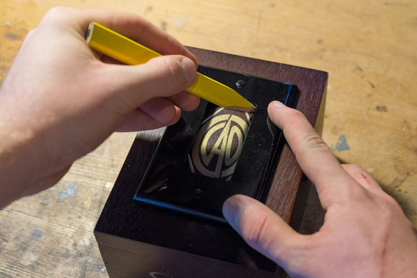 tracing a hole on a cigar box for a DIY charging station