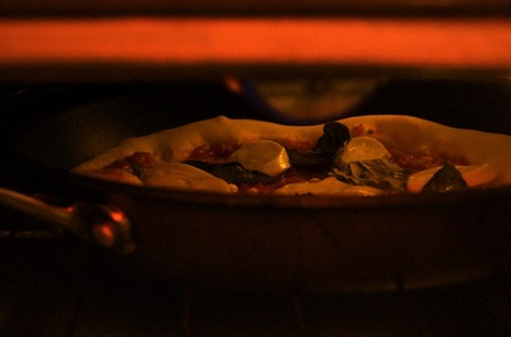 Skillet pizza in the broiler.