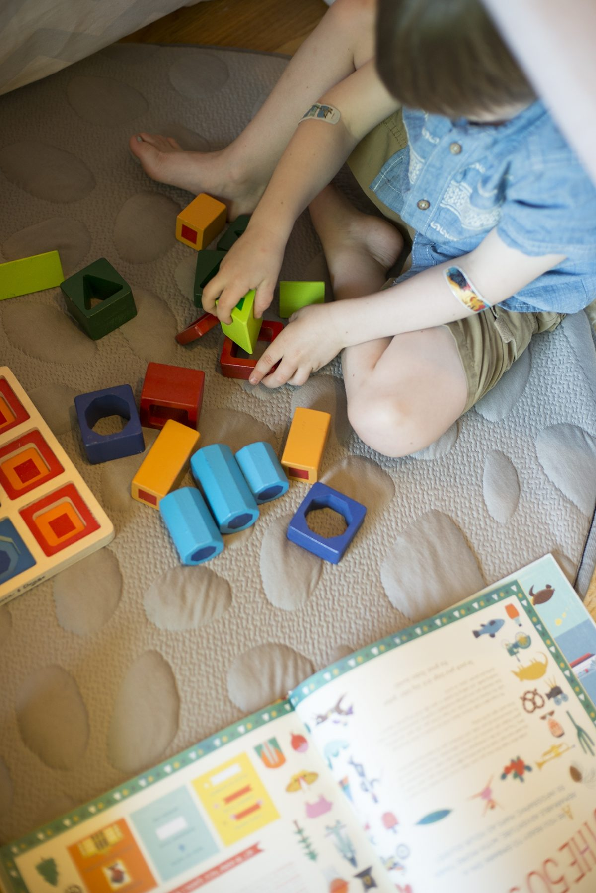 Nook Baby Products - Nook Non-Toxic LilyPad Playmat - Boy playing with blocks.jpg