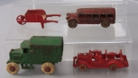 Hubley & Other Vintage Cast Iron Vehicles: Fire Truck, Bus, Delivery Truck & Whe