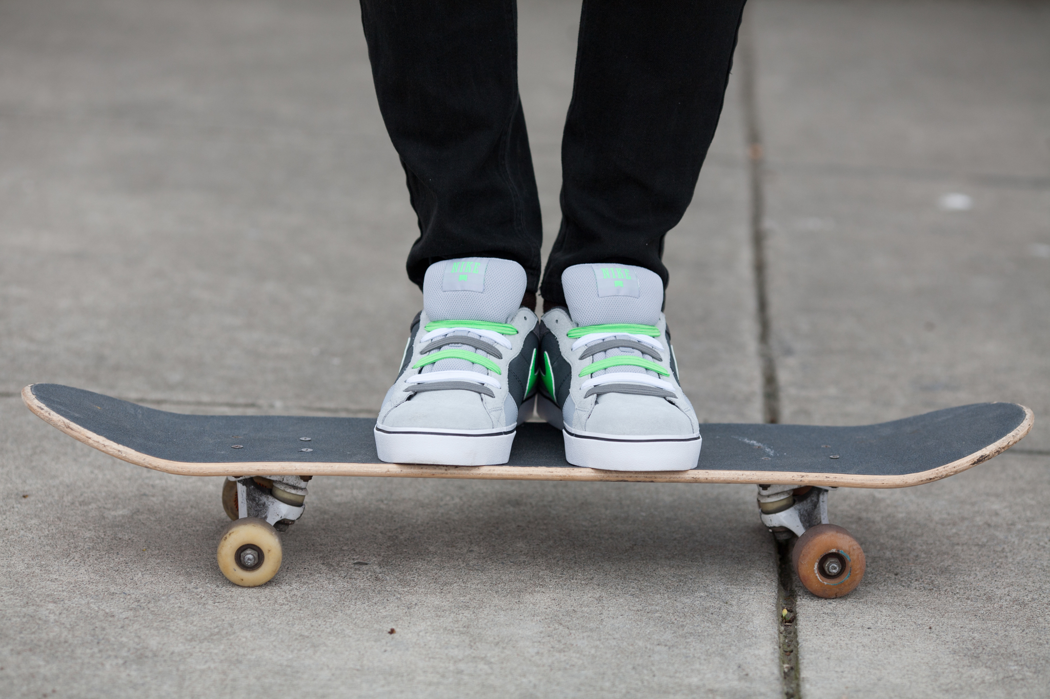 Grey shoes on skateboard