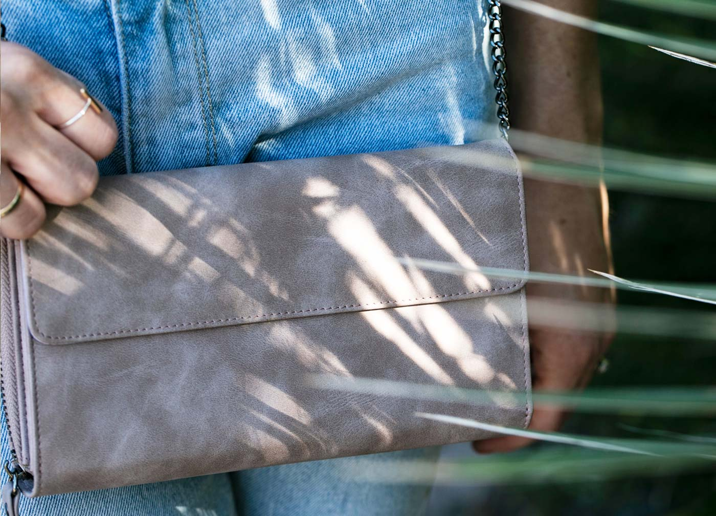 Maskcara model with Clutch Wallet in Dusty Lilac