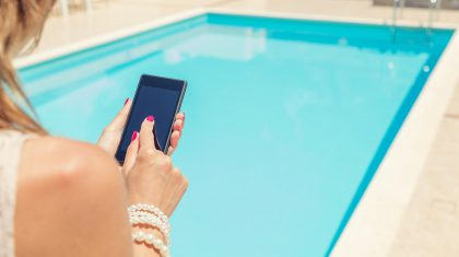 Woman with Phone at Pool