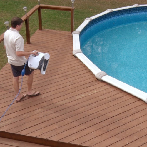 Dolphin E10 Robotic Pool Cleaner being carried