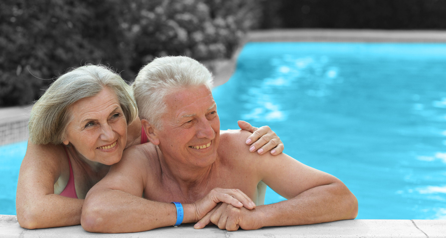Senior Couple Enjoying a Pool Cleaned by a Robotic Cleaner