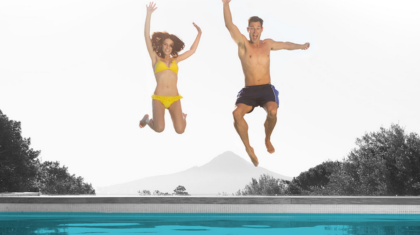 Dive into Maytronics' splashy new website today! (Woman and man pictured jumping into pool.)