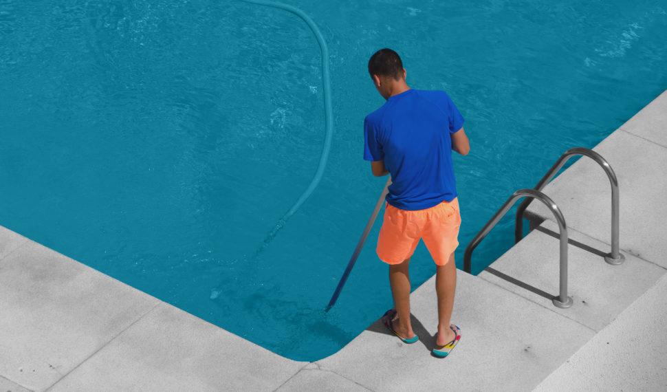 Swimming Pool Maintenance Man Cleaning Pool