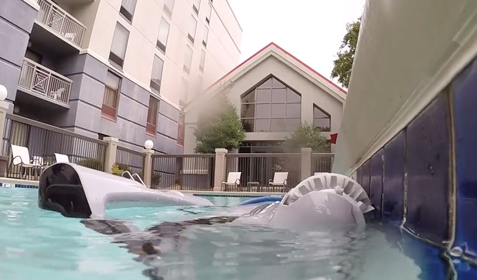 Dolphin C- Series Robot Scrubbing a Pool Waterline