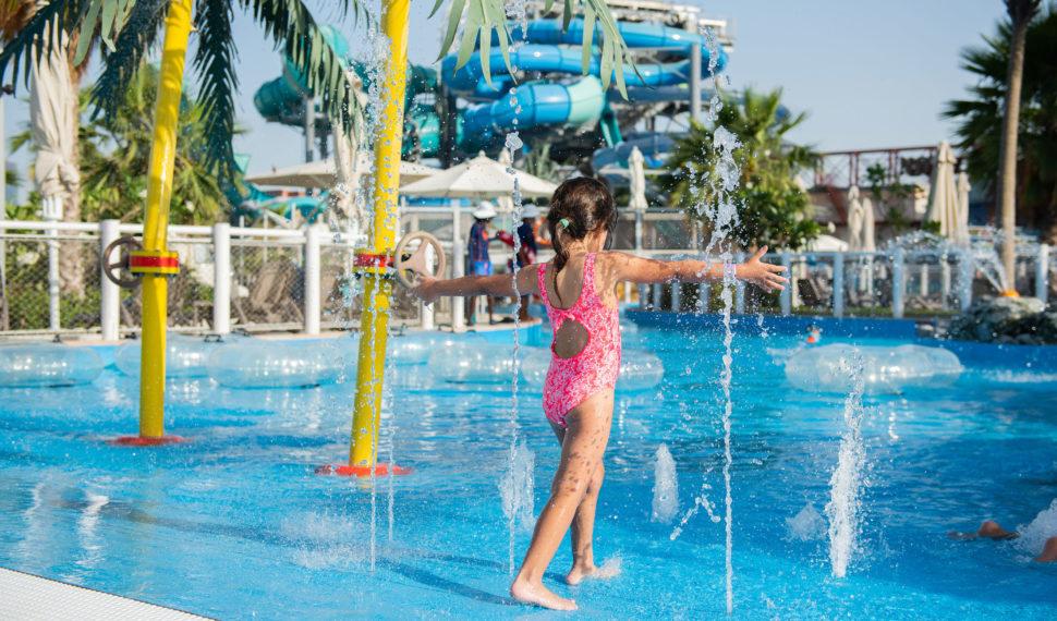 Girl Playing in Fountain Swimming Pool