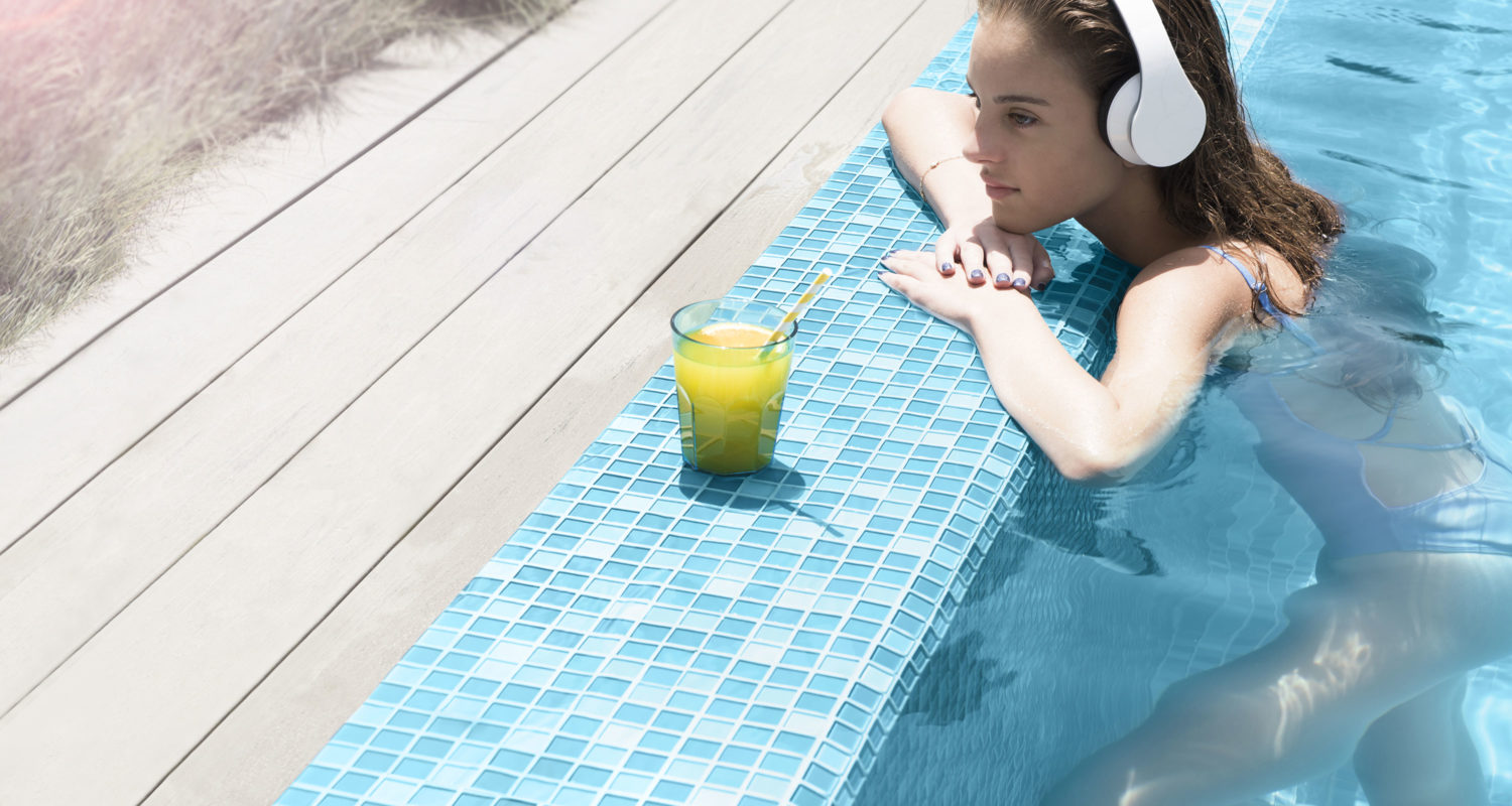 Young Woman Enjoying Juice inside the Pool
