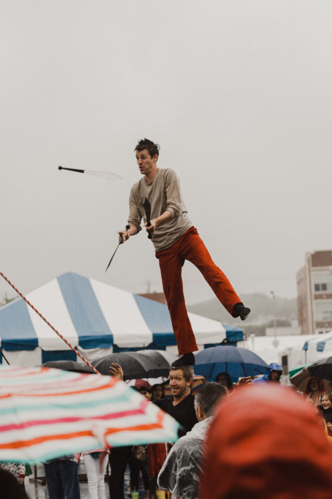 The Red Trouser guys doing a street performance at the National Folk Festival 2018