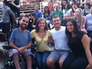 at a concert at Red Rocks with friend and best friend caregivers Kaylyn and Travis