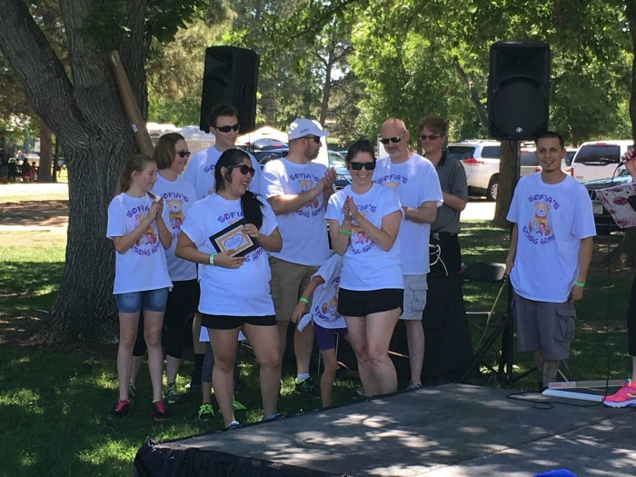 Team Sophie's Strong Arms won best team spirit for designing and making their t-shirts. Sophie (not pictured here) is a young girl who was just diagnosed with a neuromuscular disease in November. Her family was excited to team up for their first Muscle Walk!