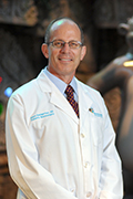 James E Baumgartner, MD