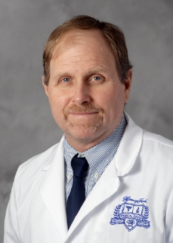 John M. Howard, MD
