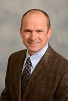 Greg L. Schumacher, MD