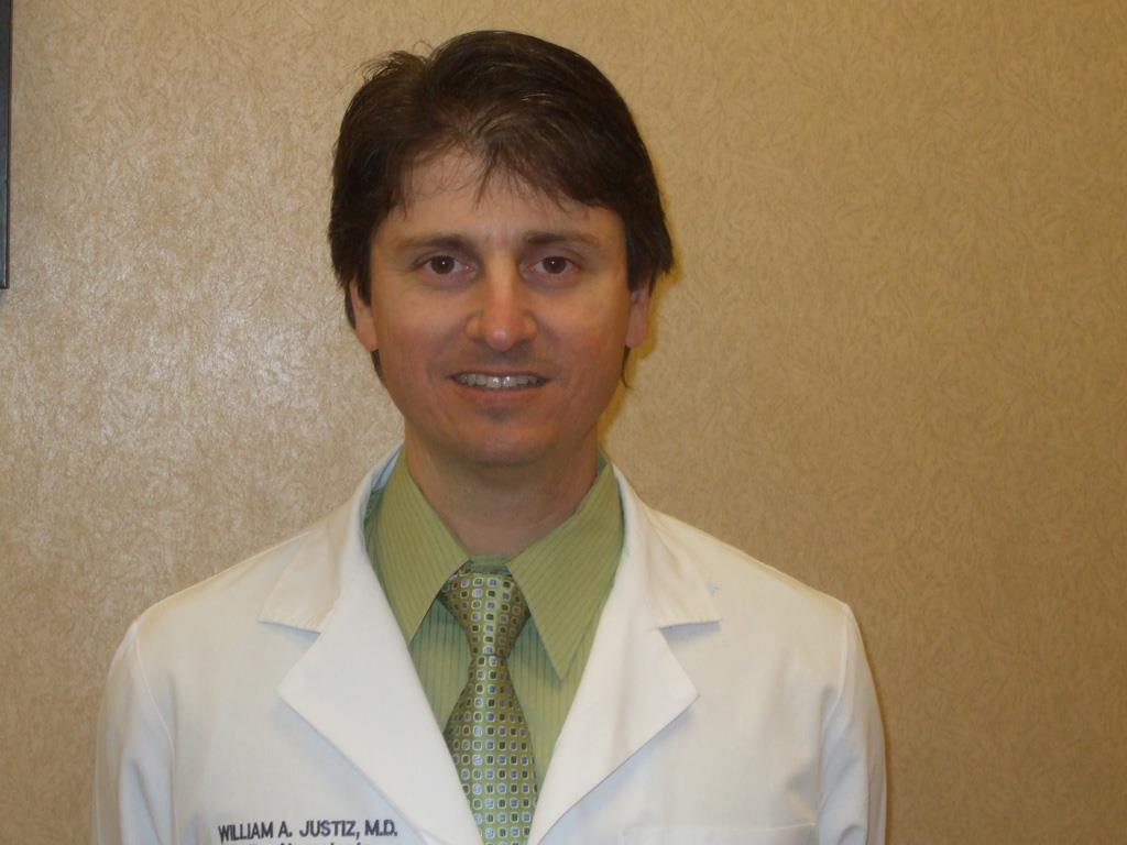 William A Justiz, MD