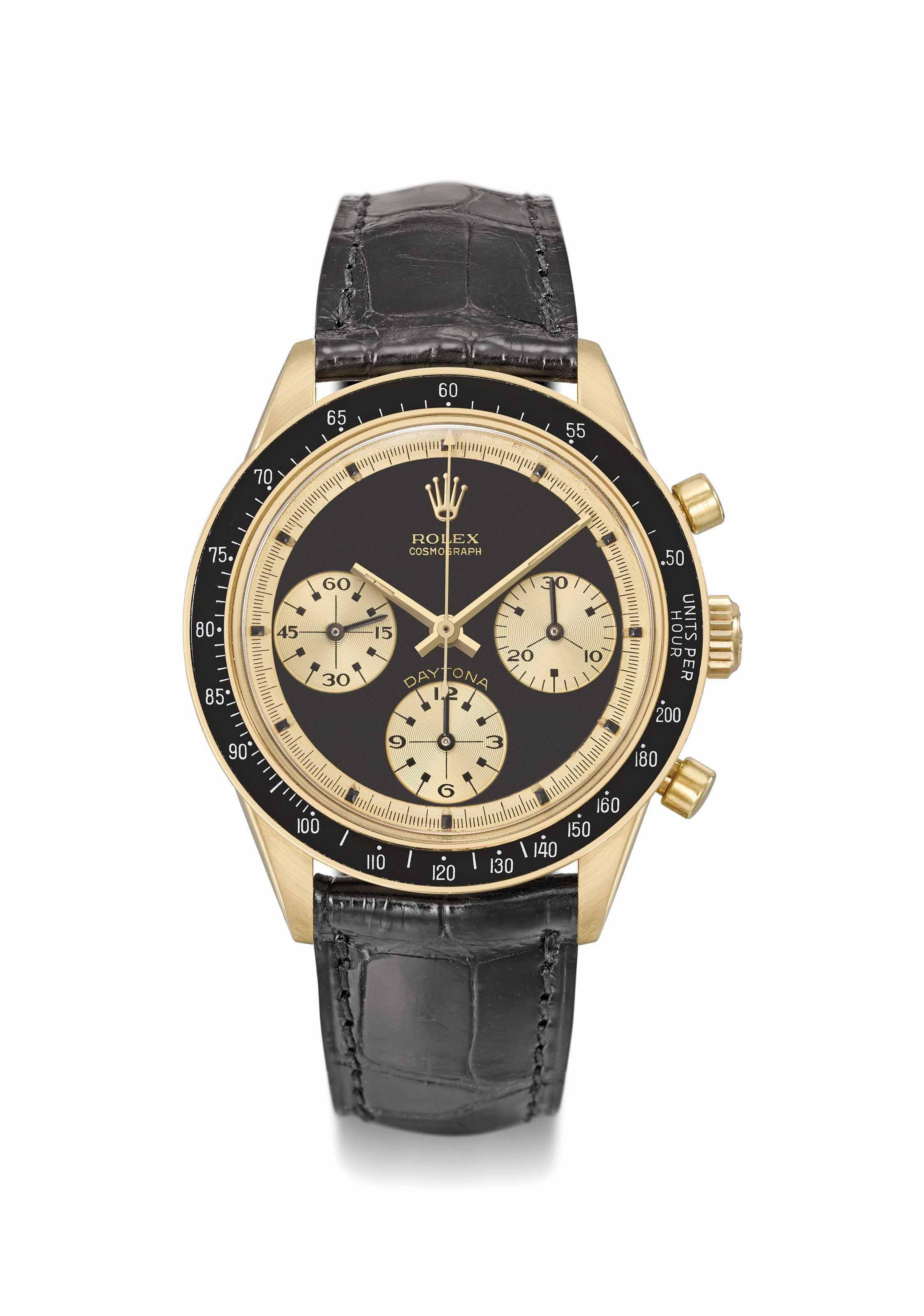"2af4ee8445e Rolex. An exceptionally rare and highly attractive 18K gold chronograph  wristwatch with black ""John Player Special Paul Newman"" dial SIGNED ROLEX,  ..."