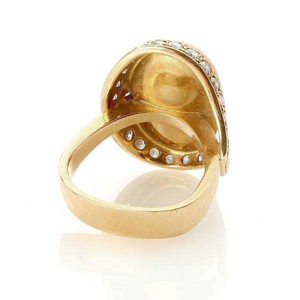 Georg Jensen: A coral and diamond ring set with cabochon-cut coral and brilliant-cut diamonds weighing a total of app. 1.24 ct. mounted in 18k gold. Size 53.5.