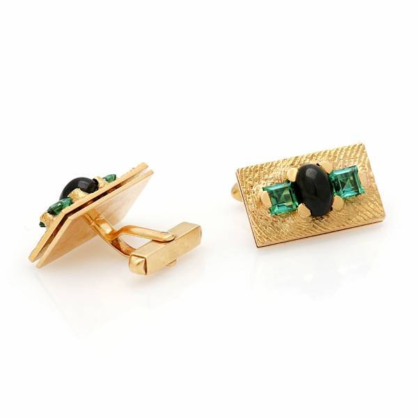 Georg Jensen & Wendel: A pair of cufflinks each set with presumable actinolite and tourmaline, mounted in 18k gold. (2)