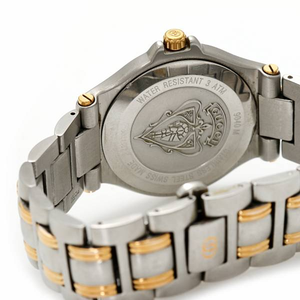 Gucci: A gentleman's wristwatch of steel and gold plated steel. Quartz movement with date. 2000.