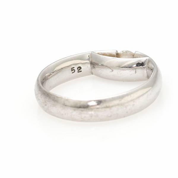 """Kim Buck: A diamond ring """"Centenary"""" set with a brilliant-cut diamond weighing app. 0.20 ct., mounted in 18k white gold. Size 52. Georg Jensen after 1945."""