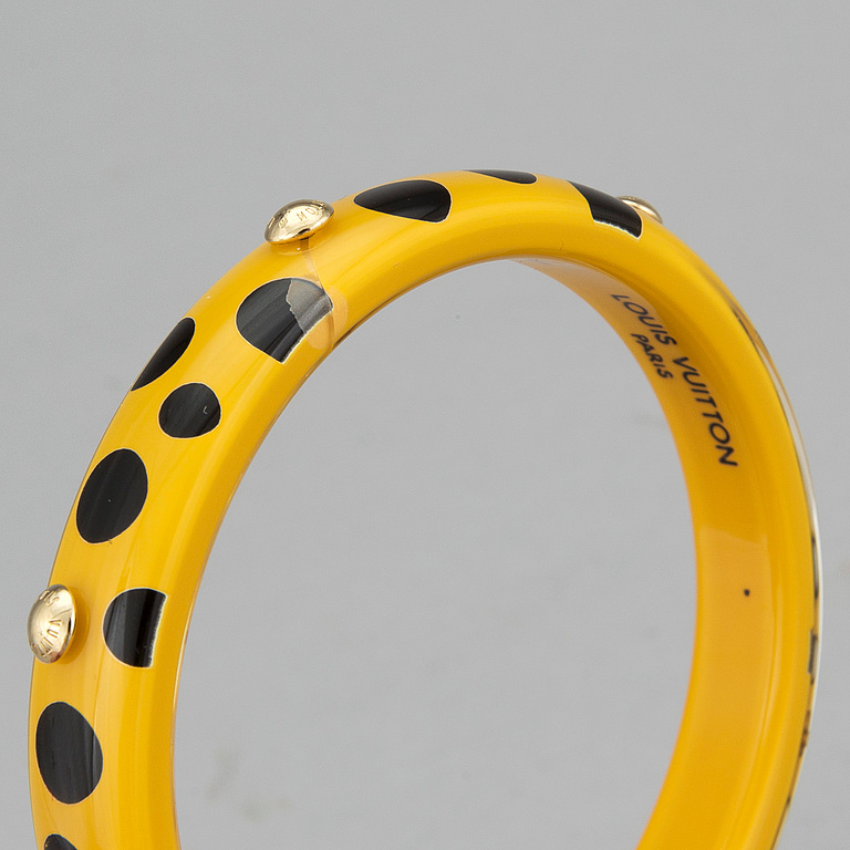 "LOUIS VUITTON. Bangle, Yayoi Kusama, Limited Edition, ""Yellow Dots Infinity PM Bangle Bracelet."""