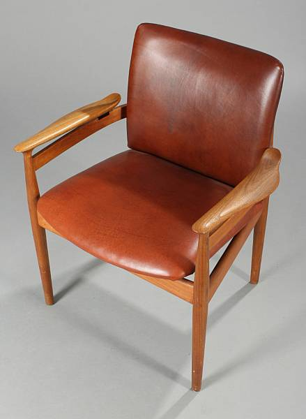 Finn Juhl: A teak armchair, upholstered in seat and back with red brown leather. Model FD 192. Designed 1959. Manufactured by France & Son.