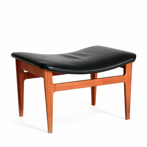 Finn Juhl: Stool with teak frame. Seat upholstered with black leather. Manufactured by France and Son.