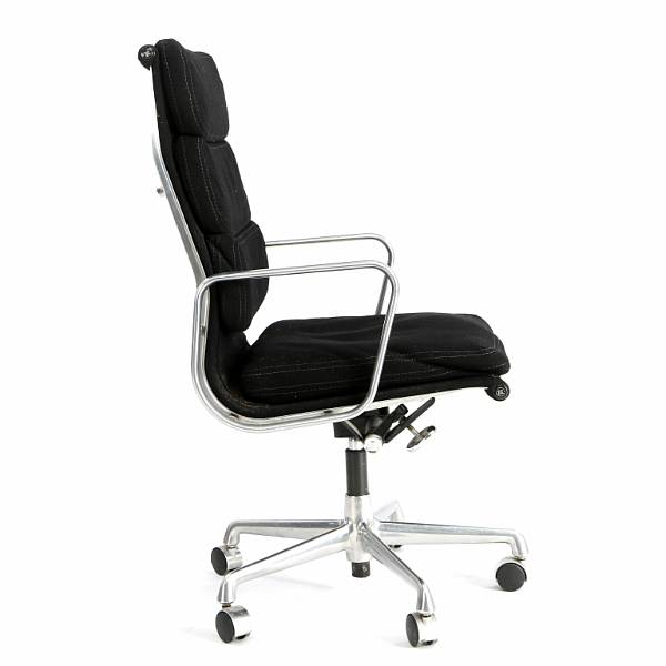 Charles Eames, Ray Eames: High backed swivel chair on castors with frame of aluminium. Seat and back upholstered with black wool. Manufactured by Herman Miller.