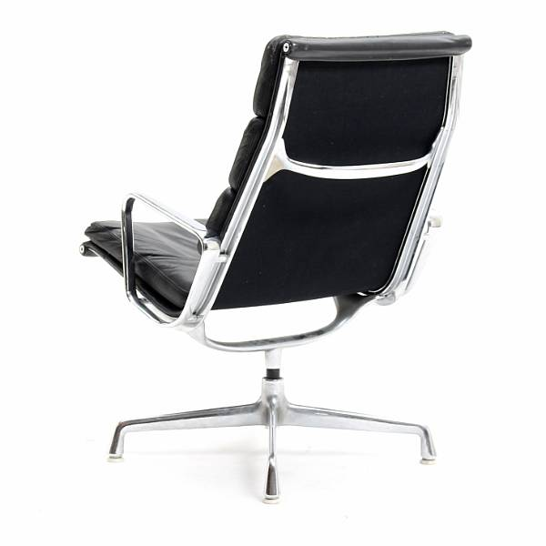 "Charles Eames, Ray Eames: ""Soft Pad Lounge Chair"". Lounge chair with chromium-plated aluminium frame, upholstered with patinated black leather."