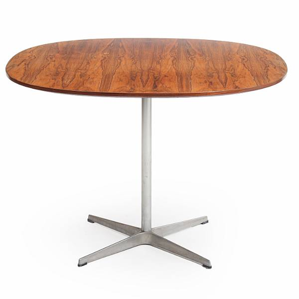 "Bruno Mathsson, Arne Jacobsen, Piet Hein: ""Supercircular"". Dining table with Brazilian rosewood top. Manufactured by Fritz Hansen. H. 70. Diam. 100 cm."