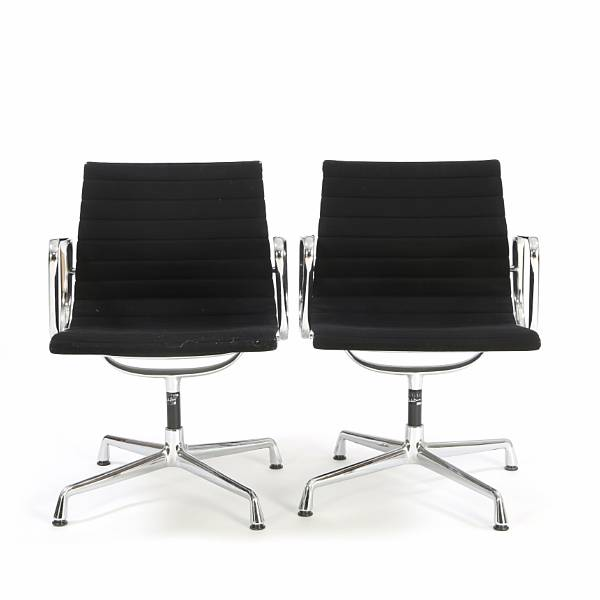 "Charles Eames, Ray Eames: ""Aluminium Group Side Chair"". A pair of swivel armchairs with frame of chromed steel. Seat and back upholstered with black fabric. (2)"