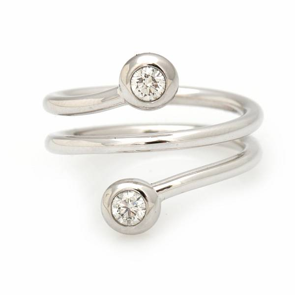 """Georg Jensen: An """"Aurora"""" ring set with two brilliant-cut diamonds totalling app. 0.30 ct., mounted in 18k white gold. G/VS. Size 56."""