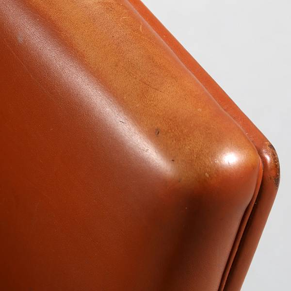 Finn Juhl: Office chair mounted on frame of aluminum with 5 wheels. Sides, seat and back upholstered with reddish brown leather.