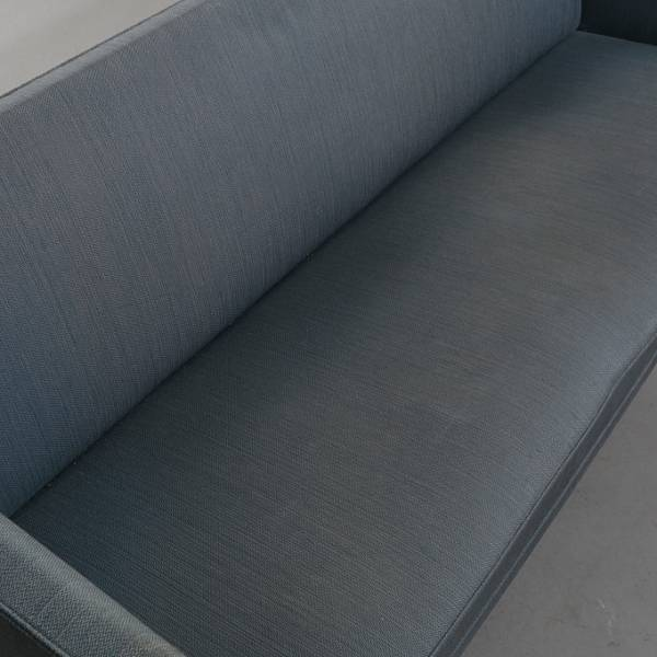 Grete Jalk: Freestanding three seater sofa with stained beech legs. Seat, sides and back upholstered with greyish blue wool. Made by Johannes Hansen. L. 175 cm.