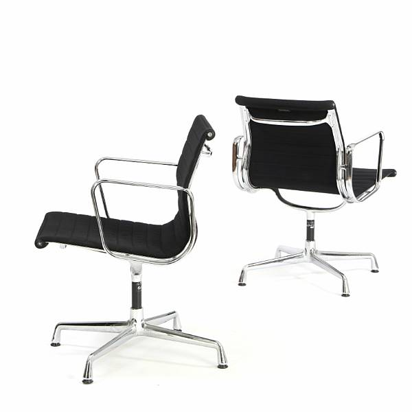 "Charles Eames, Ray Eames: Aluminium Group "". A pair of swivel chairs with chromed aluminium frame. Seat and back upholstered with black wool."