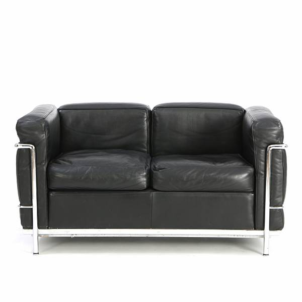 "Le Corbusier: ""LC 2"". Two seater sofa with frame of chromed steel. Upholstered with black leather. Manufactured by Cassina."