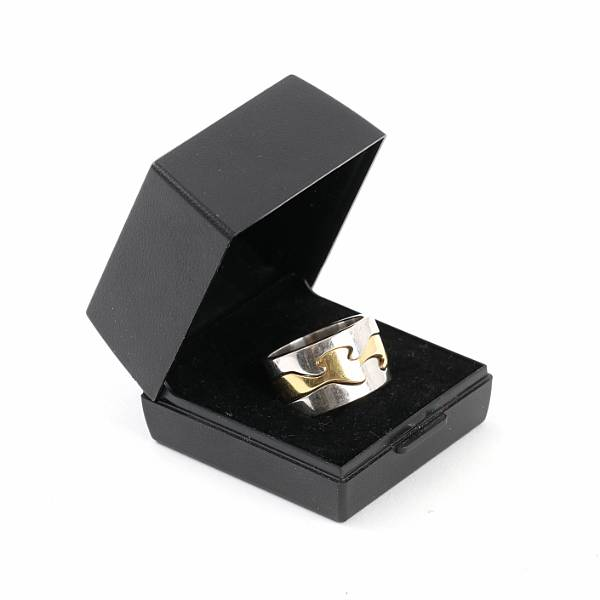 """Nina Koppel: """"Fusion"""". An 18k gold and white gold trippe ring. Manufactured by Georg Jensen. Weight app. 20 gr. Size 57. 2015."""