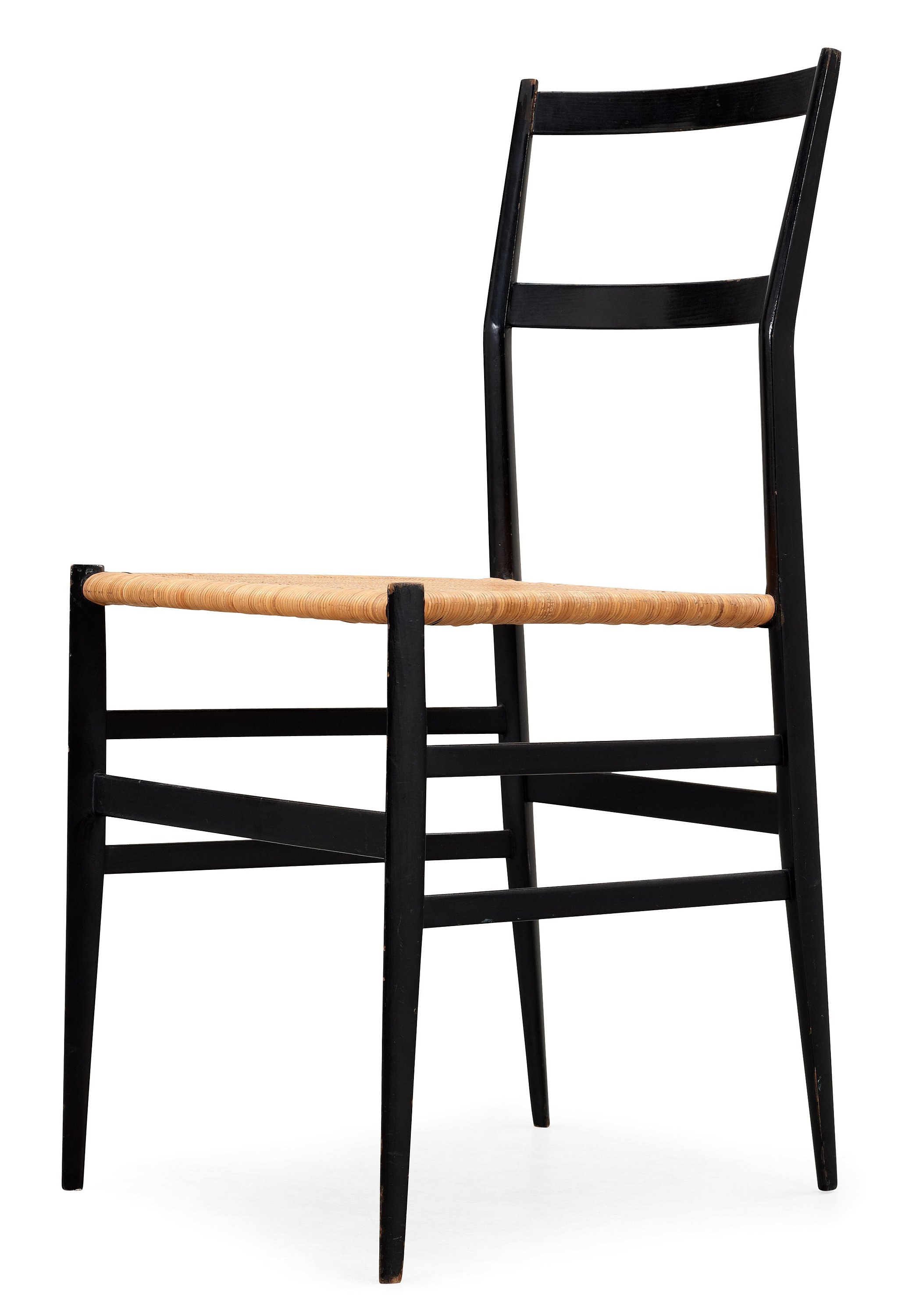A Gio Ponti 'Superleggera' chair, Cassina, Italy, black painted ash with ratten seat.