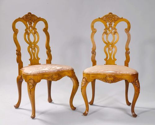 PAIR OF CHAIRS, Baroque style, Holland or Northern Germany. Walnut, carved with leaf volutes and shells. Padded sea. Pink silk cover (ripped).
