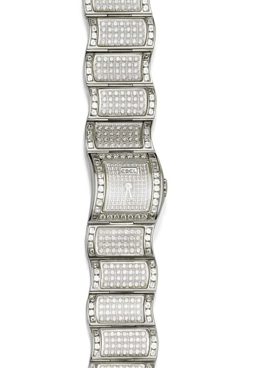 "DIAMOND LADY'S WRISTWATCH, EBEL, GEMS OF OCEAN, ca. 2002. White gold 750. Haute Joaillerie Collection: Model ""Gems of the Ocean - Vanua - Rock Crystal"", Ref. E3057H26-500, limited series No. 1/50. Case No. 8230029 integrated in the band, dial set with brilliant-cut diamonds, silver-coloured hands. Quartz movement. Very fancy bracelet with wave motif, set throughout with numerous brilliant-cut diamonds and with square-cut diamonds as the border. Total weight of the diamonds ca. 10.92 ct. L ca. 17 cm. With case, warranty and confirmation of value by Ebel."